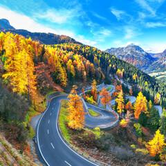 Stunning view of Maloja pass road at autumn time.