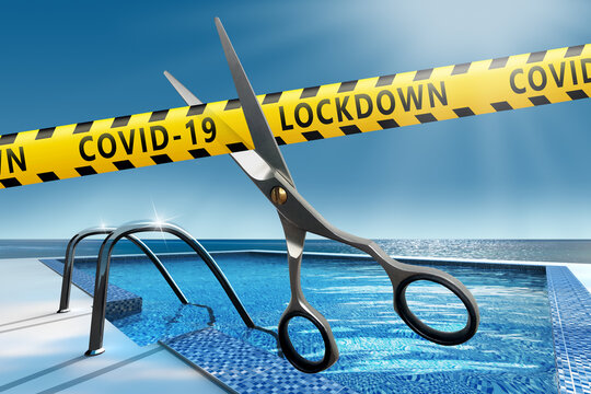 The end of the Covid 19 pandemic.  Resort opening after lockdown. Scissors cut yellow ribbons with text Covid-19 LOCKDOWN.