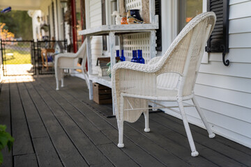 Shallow focus image of chairs on a porch on a sunny day