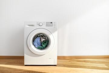 Working washing machine on white background