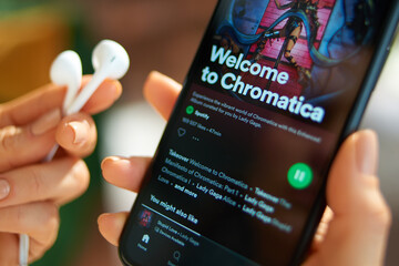 smartphone with Lady Gaga album Chromatica playing on Spotify