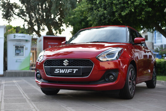 Bodrum / Turkey - 10.10.19: Suzuki Swift parked in city park near ATMs
