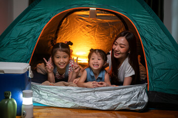 Papiers peints Camping Asian woman playing and staying in tent with her daughter and having fun with camping tent in their bedroom a staycation lifestyle a new normal for social distancing in coronavirus outbreak situation