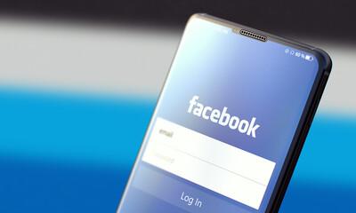 KYIV, UKRAINE-JUNE, 2020: Facebook. Studio Shot of Smartphone with Facebook Mobile Application on Blurred Back.
