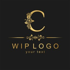 Classic logo with a flower. Gold rose on the capital letter.
