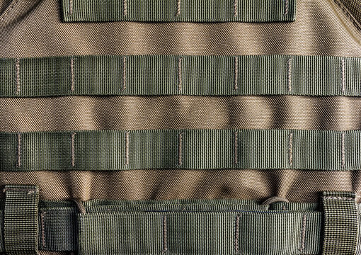 Military olive colored modern armor vest with molle system.