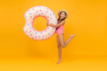 Accessories for swimming. Kid in swimsuit having fun. Summer vacation. Swimming and sunbathing. Safety on water. Safety measures around pool to keep bathers safe. Little girl and swimming donut ring
