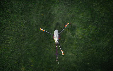 helicopter on the green grass photographed from the air