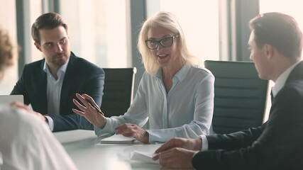 Wall Mural - Business meeting lead by middle aged woman in modern boardroom, business parties company representatives meet for plan future collaboration, discuss terms conditions sign contract solve issues concept