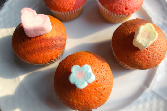 The home made cup cakes with marshmello topping.