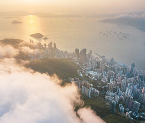 Wall Mural - Amazing aerial view of Victoria Harbour, Hong Kong, in a cloudy day