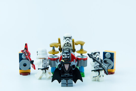 Nonthaburi, Thailand - February, 16, 2017 : Lego star wars stormtrooper and Lego Batman playing music rock band on white background copy space.Band of musicians.Nonthaburi, Thailand.