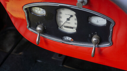 Dashboard of a red classic sports car, the Fiat 514 MM as a roadster without hood in Braunschweig, Germany, April 7. 2019