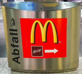 Garbage can with a sign and advertising for an American fast food restaurant in Hannover, Germany, March 22, 2019