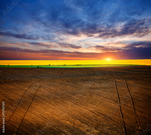 Wall mural Picturesque rural area and plowed field on the springtime. Location place of Ukrainian agrarian region, Europe.