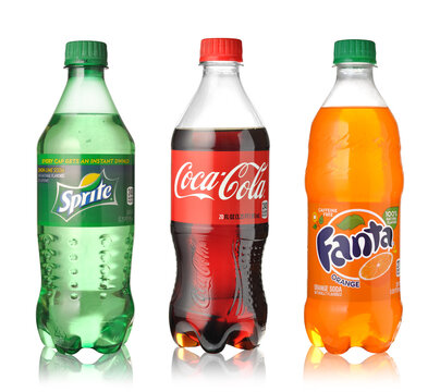 Coca-Cola, Fanta and Sprite bottles isolated on white.