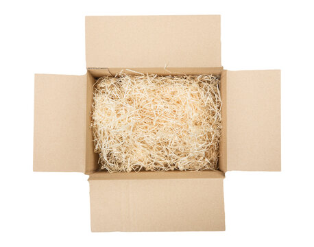 Top view of open cardboard box with shredded wood excelsior for filling inside. Using natural sustainable material for wrapping or products background. Isolated on white, studio shot.