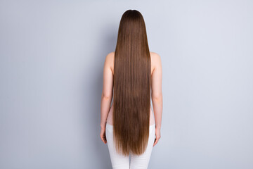 Rear back behind view photo of perfect model lady demonstrating ideal neat long hairstyle after...