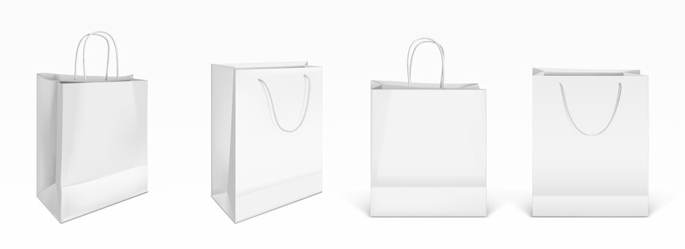 White paper shopping bags front and angle view. Vector realistic mockup of blank packet with handles isolated on white background. Template for corporate design on cardboard bag for store or market