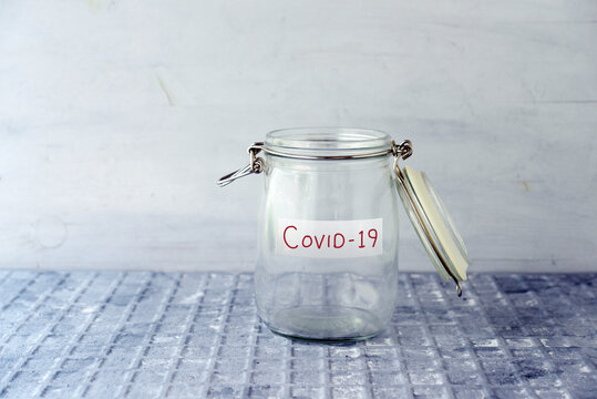 Empty money jar with covid19 label