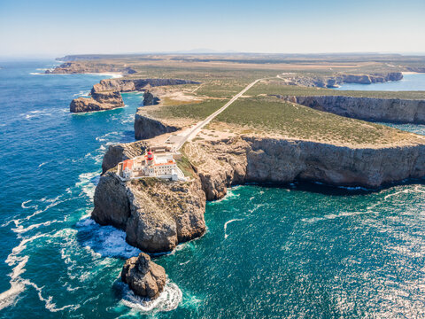 Beautiful lighthouse located on high cliffs of Saint Vincent cape in Algarve, Portugal