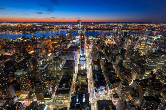 New York City, NY, USA - Mach 11, 2018: Aerial view of Midtown West Manhattan with new Hudson Yards skyscrapers under contruction at twilight