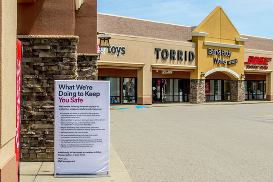 Birch Run, Michigan, USA - June 3, 2020: Sign outside of outlet mall with Bath and Body and Bose speaker store informing shoppers of changes after Coronavirus pandemic.