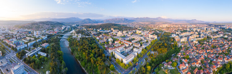 Poster Europe de l Est Podgorica, capital of Montenegro: panoramic aerial view. The city is renowned for its green parks. This small country is located on the Balkans peninsula on the Mediterranean, in South Eastern Europe.
