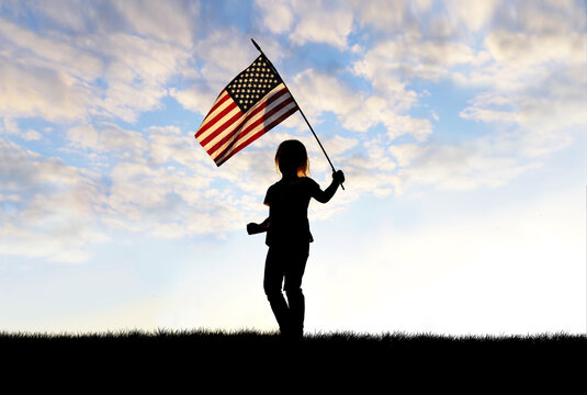 Silhouette of Patriotic Little Girl Child Waving American Flag