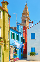 Wall Mural - Street and leaning old bell tower in Burano in Venice,