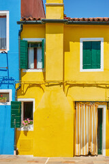 Wall Mural - Houses of contrast vivid colors in Burano in Venice