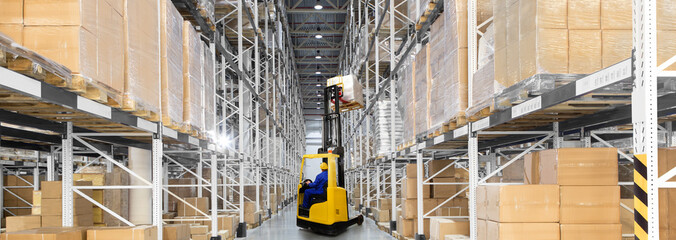 Wall Mural - A large distribution warehouse with yellow forklift