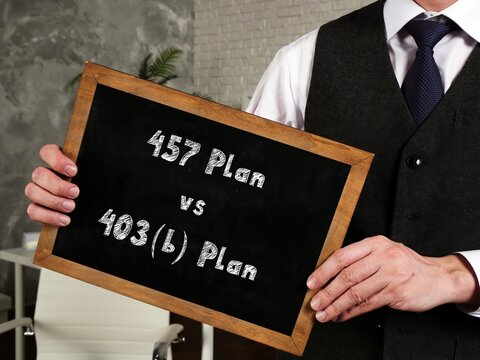Financial concept about 457 Plan Vs. 403(b) Plan with inscription on the piece of paper.