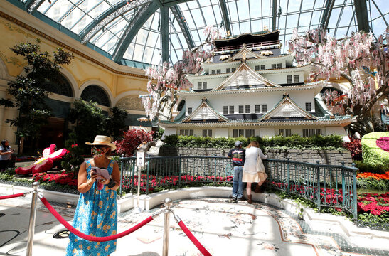 """Guests look over the """"Japanese Spring"""" display in the Bellagio Conservatory & Botanical Gardens, in Las Vegas"""