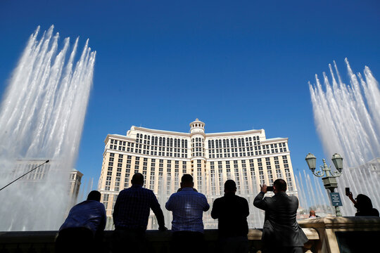 Bellagio employees watch a fountain show during the reopening of Bellagio hotel-casino, in Las Vegas