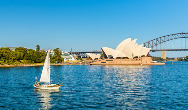 Sydney Opera House and a yacht in the Harbour - Australia, New South Wales
