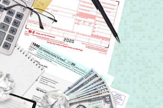IRS form 1040 Individual income tax return and W-2 wage and tax statement lies on office table and ready to fill. U.S. Internal revenue services paperwork concept. Time to pay taxes
