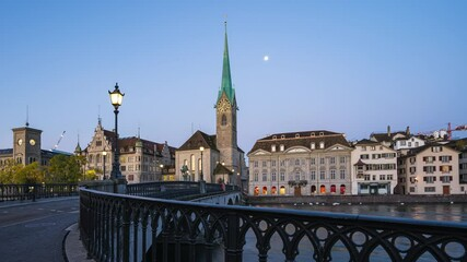 Wall Mural - Night to day time lapse of Zurich city with view of Fraumunster church in Switzerland