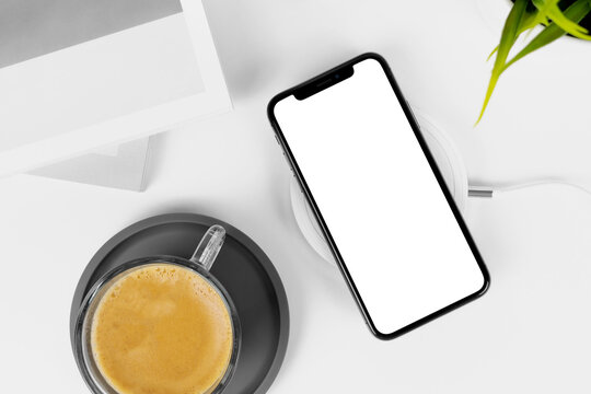 Bangkok, Thailand - Sep 4, 2019: Smartphone frameless mockup. Studio shot of Smartphone iPhone 11 Pro Max with blank screen for Infographic Global Business web site design app -include clipping pat