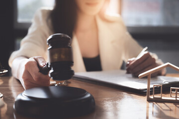 Business woman or lawyers checking contract papers with on wooden desk in office. Law, legal services, advice, Justice concept.