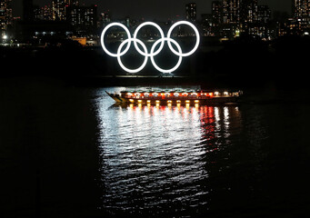 A Japanese-style tour boat sails in front of giant Olympic rings at the waterfront area during the spread of the coronavirus disease (COVID-19) in Tokyo