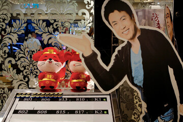 A cut-out figure of a Japanese actor is displayed at the entrance of a massage parlour that targets foreign tour groups in Taipei