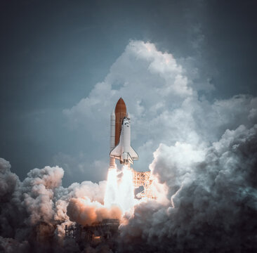 Space shuttle launches with dramatic smoke