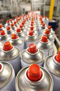 Aerosol production conveyor with aerosol cans