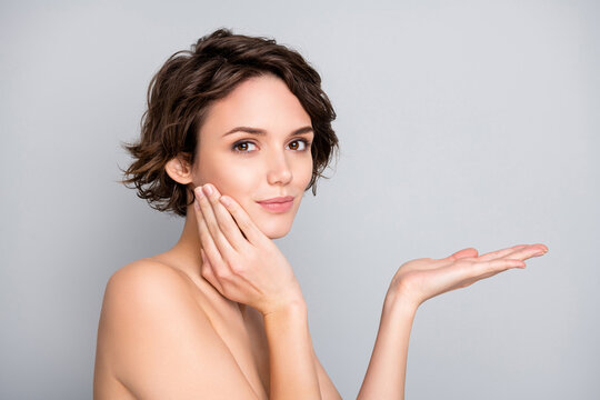 Portrait of charming dreamy girl hold hand touch finger cheeks recommend new bodycare plastic surgery treatment make skin ideal perfect natural aesthetic isolated over gray color background