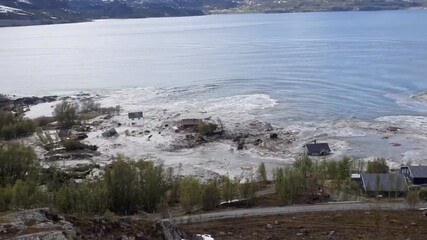 Houses fall into the water during a landslide in Alta