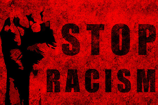 Stop racism. Red fist raised with a powerful anti-racist message.