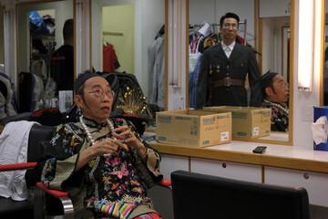 """Ng Chi-sam and Tsang Chi-ho, hosts of Radio Television Hong Kong (RTHK)'s satirical comedy show """"Headliner"""" rest at a dressing room in Hong Kong"""
