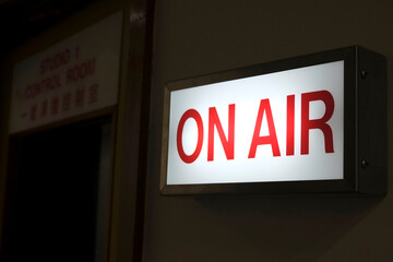 """An """"On Air"""" sign in a broadcasting studio is seen at a building of Radio Television Hong Kong (RTHK) in Hong Kong"""