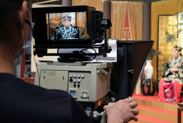 """Ng Chi-sam, host of Radio Television Hong Kong (RTHK)'s satirical comedy show """"Headliner"""" is seen on a camera during the show in Hong Kong"""